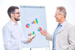 Business colleagues cooperating with each other Royalty Free Stock Photography