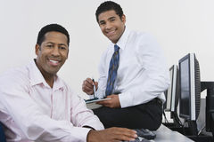 Business Colleagues At Desk Royalty Free Stock Photos