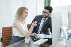 Business colleagues discussing financial documents Royalty Free Stock Photography