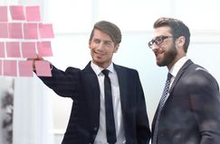 Business colleagues discussing stickers-notes on the office Board stock photography