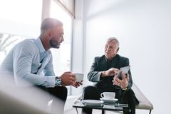 Business colleagues discussing work during break royalty free stock images