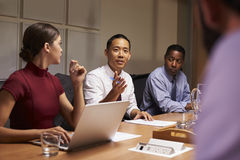 Business colleagues in discussion at a meeting, close up royalty free stock image