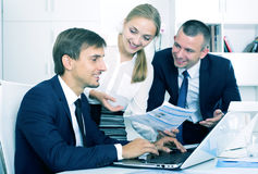 Business colleagues with document in hands Stock Photos