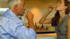 Business colleagues drinking a shot together stock video footage