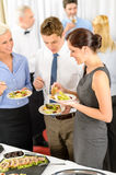 Business colleagues eat buffet appetizers Stock Photo