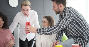 Business colleagues enjoying social media content on phone stock video