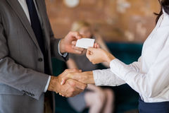 Business colleagues exchanging business card Stock Image