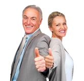 Business colleagues gesturing a success sign Stock Photo