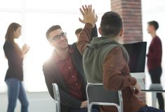 Business colleagues giving each other high five. The concept of teamwork stock photos