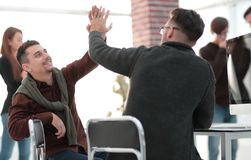 Business colleagues giving each other high five. The concept of teamwork stock photo