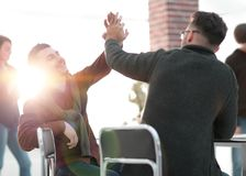 Business colleagues giving each other high five. The concept of teamwork royalty free stock photography