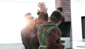 Business colleagues giving each other high five. The concept of teamwork royalty free stock photos