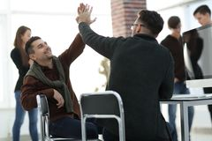 Business colleagues giving each other high five. The concept of teamwork royalty free stock photo