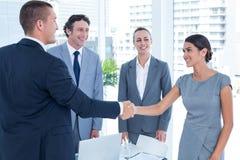 business colleagues hands shaking Стоковые Изображения RF