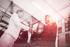Business colleagues handshaking Stock Photos