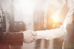 Business colleagues handshaking Stock Images