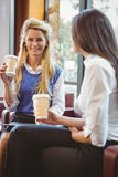 Business colleagues holding coffee cup and digital tablet Royalty Free Stock Image