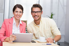 Business colleagues holding coffee cup and digital tablet Stock Photos