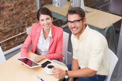 Business colleagues holding coffee cup and digital tablet Stock Photography