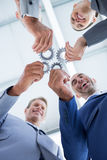 Business colleagues holding cog Royalty Free Stock Image