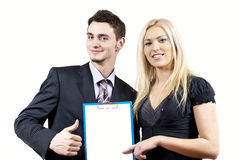 Business colleagues holding a folder Royalty Free Stock Photos