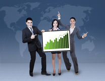 Business colleagues holding growth graph Royalty Free Stock Image