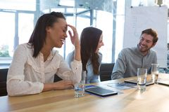 Business colleagues interacting with each other in conference room. At home Stock Photo