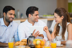 Business colleagues interacting with each other while having breakfast Stock Photo