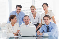 Business colleagues with laptop at desk Stock Photography