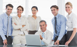 Business colleagues with laptop at desk Royalty Free Stock Photo