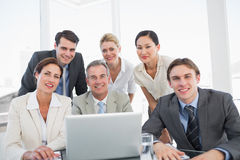 Business colleagues with laptop at office desk Royalty Free Stock Photo