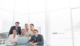 Business colleagues with laptop at office desk Stock Images