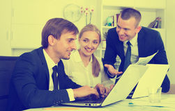 Business colleagues with laptops in office Royalty Free Stock Photo