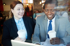 Business Colleagues Laughing in Coffee Shop after Work stock images