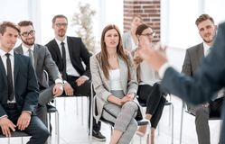 Business colleagues listen to the speaker at a business conference. Business and education royalty free stock photography