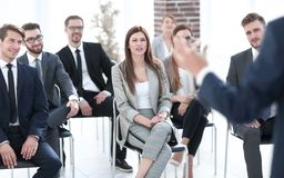 Business colleagues listen to the speaker at a business conference. Business and education royalty free stock image
