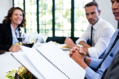 Business colleagues looking at a file and discussing Stock Photography