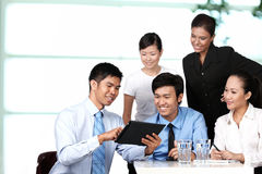 Business colleagues looking at a touchpad Stock Photography