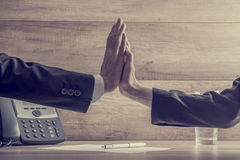 Business colleagues making high five gesture over a contract Stock Photos
