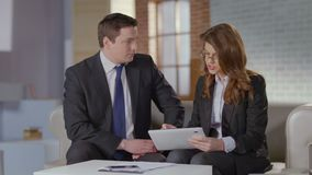 Business colleagues at meeting, man woman discussion slow-motion. Stock footage stock footage