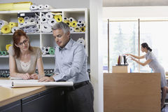 Business Colleagues With Paperwork In Office Royalty Free Stock Photos