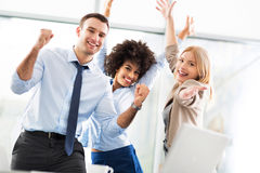 Business colleagues. Business people cheering with arms raised stock photos