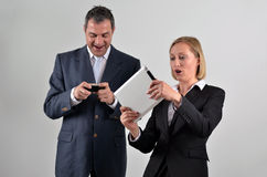 Business colleagues playing video games Stock Images