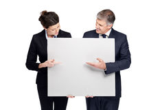 Business colleagues pointing at a empty board Stock Photography