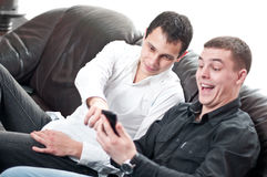 Business colleagues reading funny message. Isolated top Stock Image