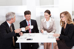 Business colleagues relaxing over coffee stock images