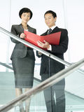 Business Colleagues Reviewing Documents On Stairs Stock Images