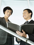Business Colleagues Reviewing Documents On Stairs Royalty Free Stock Photography