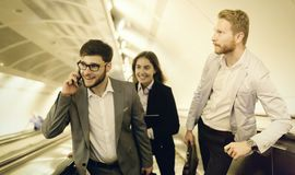 Business colleagues taking subway after work Royalty Free Stock Photo