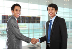 Business colleagues shaking hands Stock Photos